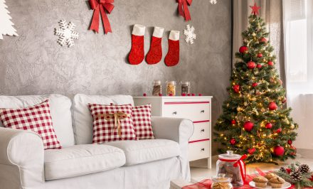 Modern living room in grey and white with christmas tree and DIY wall decor